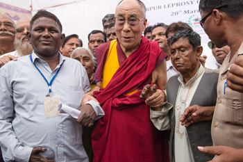 His Holiness the Dalai Lama with residents of the Tahirpur Leprosy Complex in New Delhi, India on March 20, 2014. Photo/Tenzin Choejor/OHHDL
