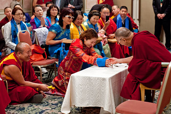 A member of a group from Mongolia presenting an offering to His Holiness the Dalai Lama during his last day in Tokyo, Japan on April 18, 2014. Photo/Office of Tibet, Japan