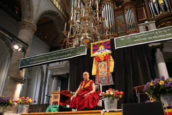 His Holiness the Dalai Lama speaking to members of the Tibetan community living in Nordic countries at the church of Laurenskerk in Rotterdam, Holland on May 10, 2014. Photo/Jeppe Schilder