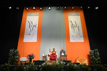 "His Holiness the Dalai Lama speaking on ""Compassion and Self Awareness"" at Fraport Arena in Frankfurt, Germany on May 14, 2014. Photo/Manuel Bauer"