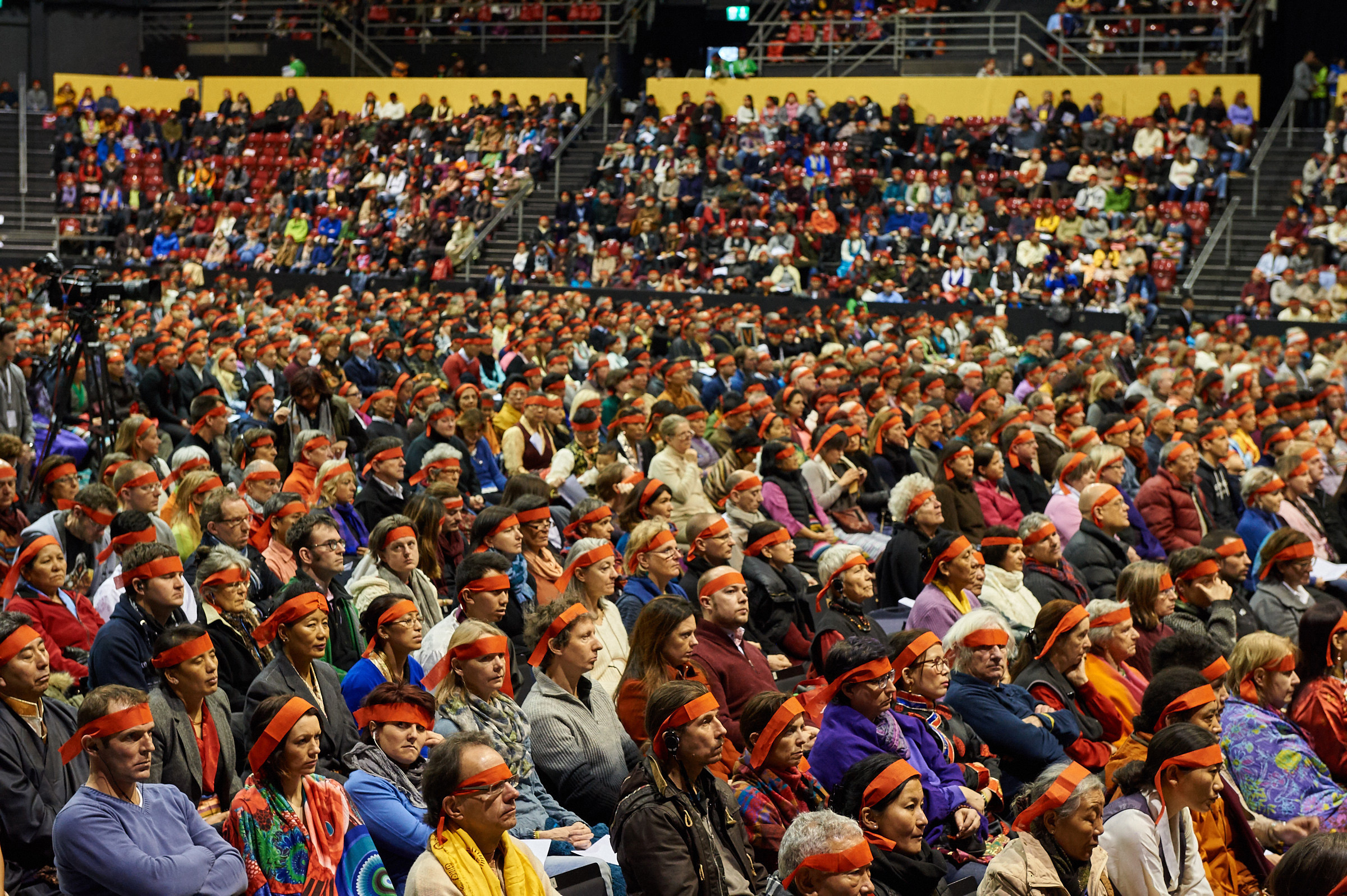 A view of the audience wearing ritual blindfolds is Holiness the Dalai Lama's conferring of the Avalokiteshvara Empowerment at St Jakobshalle in Basel, Switzerland on February 8, 2015. Photo/Olivier Adam