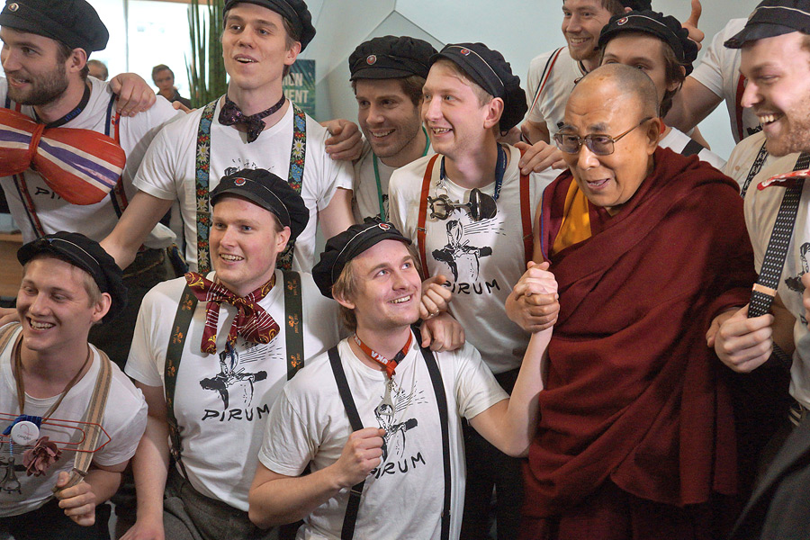 His Holiness the Dalai Lama with members of a student singing group that performed on his arrival at the Clarion Conference Centre to attend the the International Student Festival in Trondheim (ISFiT) at the Congress Center in Trondheim, Norway on February 9, 2015. Photo/Jeremy Russell/OHHDL