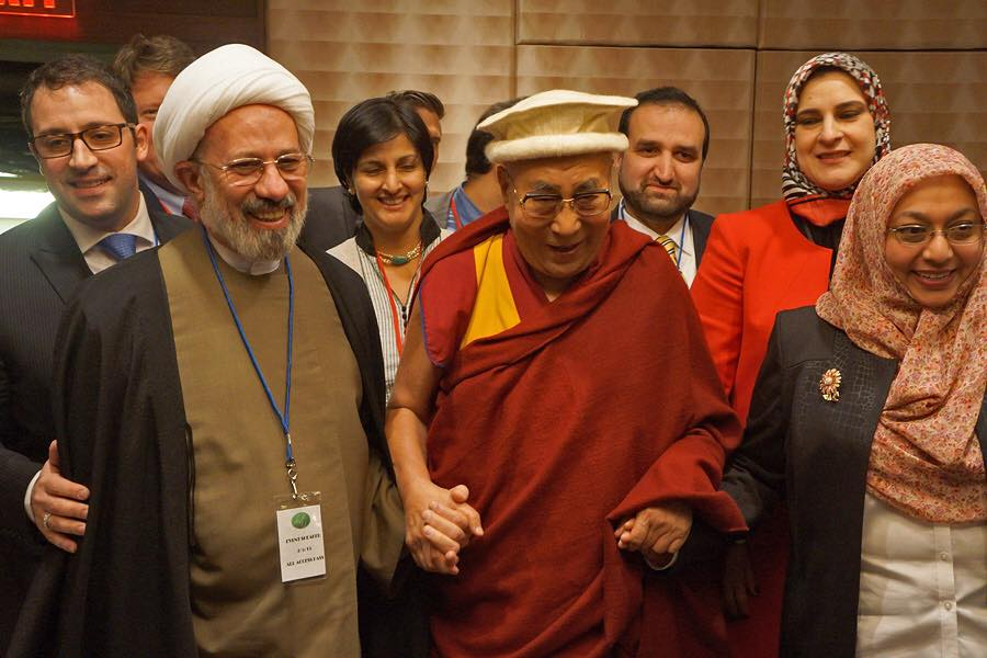 His Holiness the Dalai Lama, wearing a Balti hat, with fellow participants from the American Muslim Community after their panel discussion on Service in Action in Washington, DC on February 5, 2015. Photo/Jeremy Russell/OHHDL