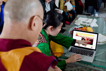His Holiness the Dalai Lama looking at the Japanese version of his office's website in Tokyo, Japan on April 5, 2015. Photo/Tenzin Jigmey