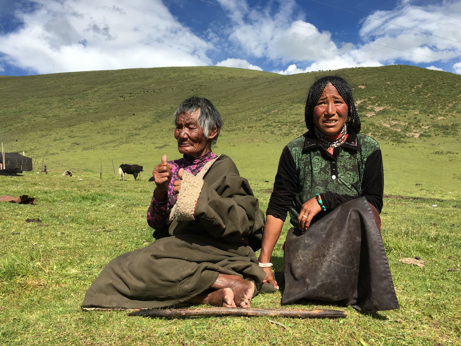 Tsering Tso's grandmother, Lhadhey, 83, and mother, Adhey, 49, on the grasslands outside the small town of Chalong in China's western Sichuan province. Last October, Tibetans protested in Chalong after 27-year-old Tsering Tso was found hanged from a bridge in the town, prompting mass arrests, beatings and a government crackdown. (Xu Yangjingjing/The Washington Post). (Xu Yangjingjing/TWP)