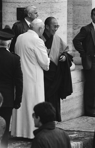Pope John Paul II and the Dalai Lama shake hands as they met outside the basilica of Santa Maris degli Angeli where 200 representatives of 12 religions gathered for a World Day of Prayer for Peace in Assisi on Monday, Oct. 27, 1986. (AP Photo/Foggia)