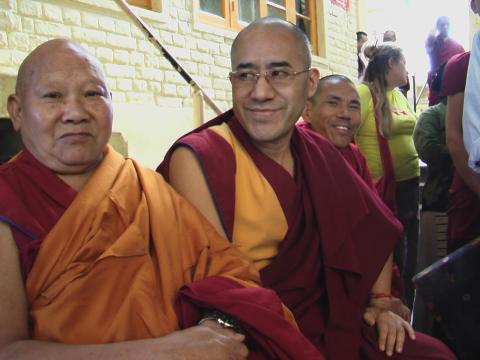 Monks smiling